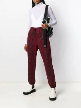 T By Alexander Wang - snake print trousers 09955369506336500000